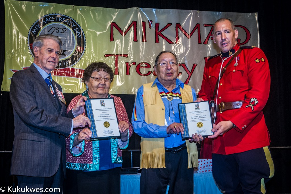 Margaret (Ma'git) Poulette (second from left, and Grand Chief Ben Syliboy receive the 2015 Grand Chief Donald Marshall Senior Elder Achievement Award