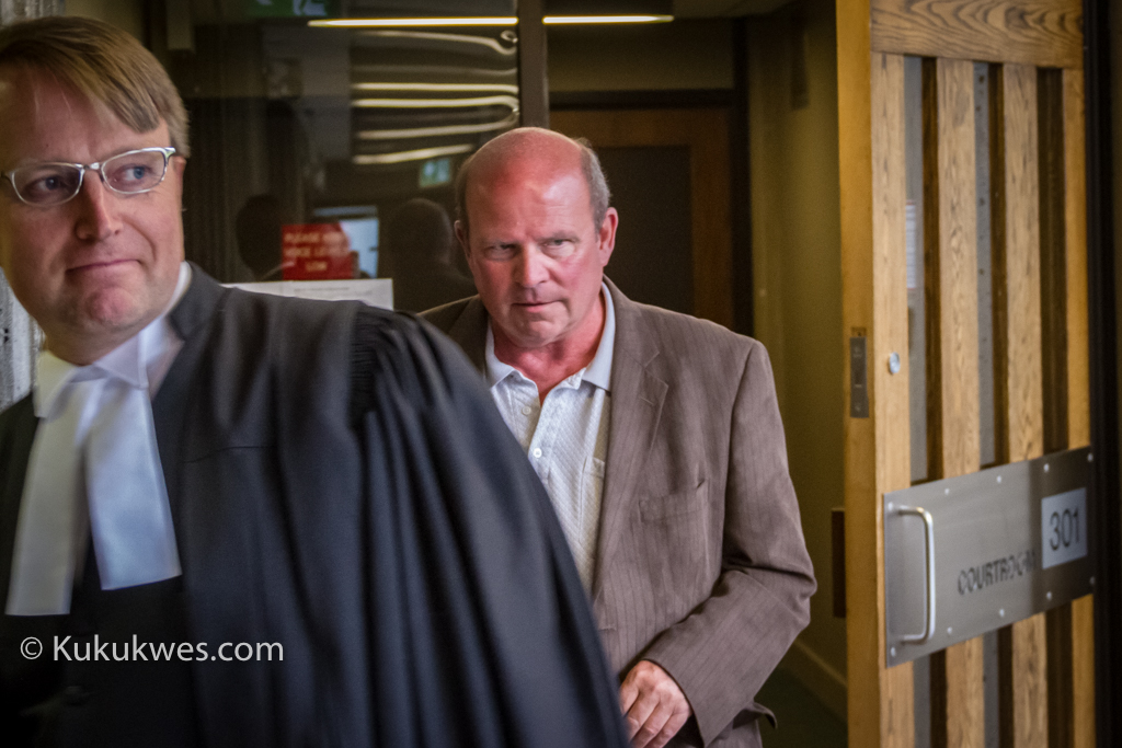 Lawyer Luke Craggs and Jeffrey Hayes leave the courtroom June 16 after a jury found Hayes guilty in theft, fraud trial/Photo by Stephen Brake