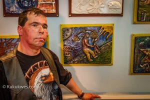 David Ladouceur, 52, stands by the clay tile he created for the project, This Is What I Wished You Knew/Photo by Stephen Brake