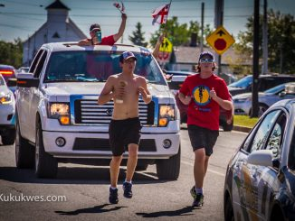 Brothers Peter Googoo (left) and Sheldon Googoo, Jr. run the final leg of the 325 km scroll run from Millbrook to Membertou/Photo by Stephen Brake
