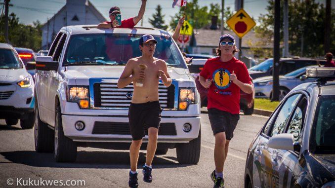 Brothers Peter Googoo (left) and Sheldon Googoo, Jr. run the final leg of the 325 km scroll run from Millbrook to Membertou/Photo by Stephen Brake