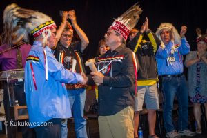 Millbrook Chief Bob Gloade hands over the scroll to Membertou Chief Terry Paul to officially start the 2016 Nova Scotia Mi'kmaw Summer Games/Photo by Stephen Brake