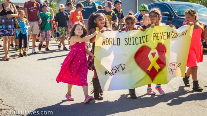 Students with LSK lead a group of 100 who marched through Indian Brook First Nation, N.S. to on Sept. 10 to mark World Suicide Prevention Day/Photo by Stephen Brake