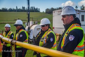 Security guards for Alton stand along the gated entrance to the project site during the news conference Sept. 26/Photo by Stephen Brake
