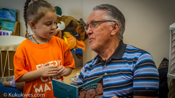 Mi'kmaw linguist Bernie Francis reads one of the recommended books in the new Mi'kmaq Resource Guide for parents of four-year-old children/Photo by Stephen Brake
